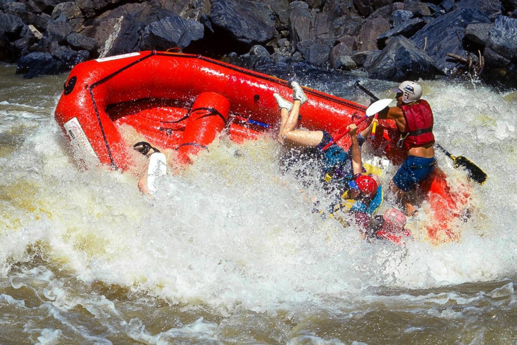 A raft capsizes in 4-Man Hole rapid on the Tugela River, South Africa.