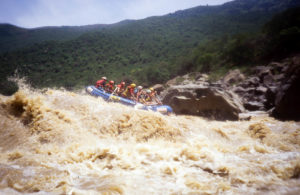 A raft navigates 4-Man Hole rapid.